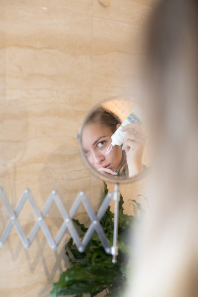 woman applying her daily skincare