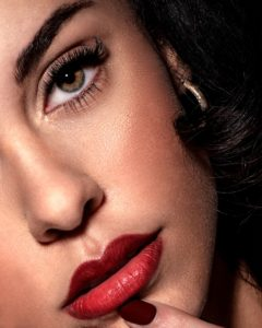 woman with red lipstick and black mascara